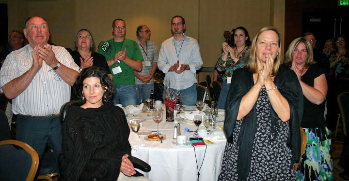 Photo of people clapping at the Banquet